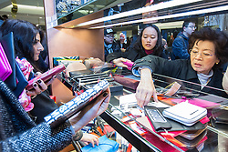© Licensed to London News Pictures . 26/12/2014 .  Manchester , UK . Shoppers pick through handbags in Selfridges in Manchester City Centre for the Boxing Day Sale . Photo credit : Joel Goodman/LNP