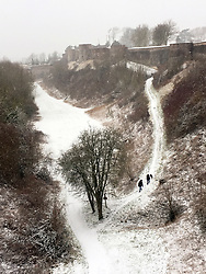 09 February 2018. Montreuil Sur Mer, Pas de Calais, Hauts de France.<br /> The snow arrived early in the morning making for some wintry scenes in the ancient citadel town of Montreuil Sur Mer. <br /> Photo©; Charlie Varley/varleypix.com