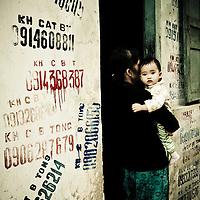 Mother holding child, French Quarter, Hanoi, Vietnam
