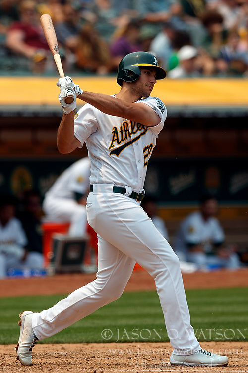 OAKLAND, CA - JULY 01:  Matt Olson #28 of the Oakland Athletics hits an RBI double against the Cleveland Indians during the fourth inning at the Oakland Coliseum on July 1, 2018 in Oakland, California. The Cleveland Indians defeated the Oakland Athletics 15-3. (Photo by Jason O. Watson/Getty Images) *** Local Caption *** Matt Olson