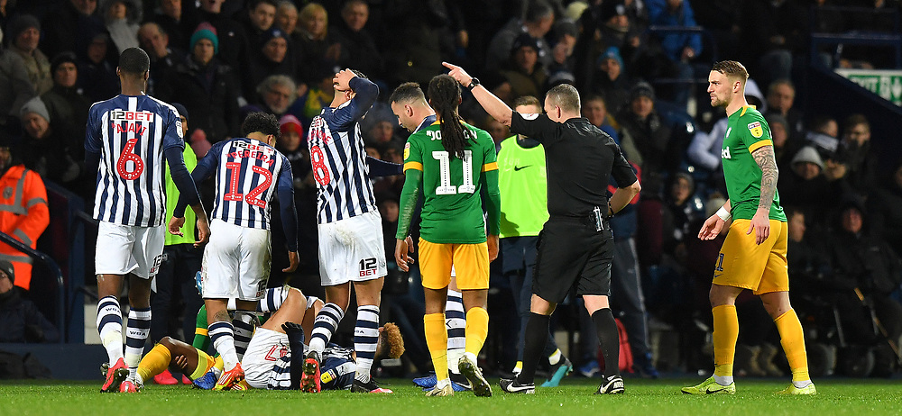 Referee Kevin Friend points the way to Preston North End's Darnell Fisher<br /> <br /> Photographer Dave Howarth/CameraSport<br /> <br /> The EFL Sky Bet Championship - West Bromwich Albion v Preston North End - Tuesday 25th February 2020 - The Hawthorns - West Bromwich<br /> <br /> World Copyright © 2020 CameraSport. All rights reserved. 43 Linden Ave. Countesthorpe. Leicester. England. LE8 5PG - Tel: +44 (0) 116 277 4147 - admin@camerasport.com - www.camerasport.com