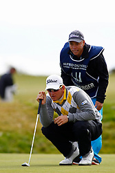 04.10.2012, Old Course, St. Andrews, SCO, European Golf Tour, Alfred Dunhill Links Championship, im Bild Bernd Wiesberger (AUT) and his caddie line up a putt // during the European Golf Tour, Alfred Dunhill Links Championship at the Old Course, St. Andrews, Scotland on 2012/10/04. EXPA Pictures © 2012, PhotoCredit: EXPA/ Mitchell Gunn
