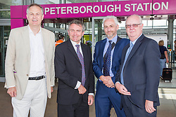 Image ©Licensed to i-Images Picture Agency. 04/07/2014. <br /> <br /> Under Secretary for transport MP Robert Goodwill arrives in Peterborough, with Ian Bates Cambs County Counciillor, Simon Machen Peterborough city Council and MP Stewart Jackso, after traveling the entire A47 from Gt Yarmouth to Peterborough.<br /> <br /> <br /> Picture by Terry Harris / i-Images