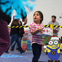 121714      Cayla Nimmo<br /> <br /> Tanya Gasperwalks with her gift she received at the Marine Corps Reserve Toys for Tots event held at the Zuni Wellness Center Wednesday.