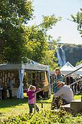 Family relaxing Ritter Island, Thousand Springs Art Festival, Hagerman, Idaho.