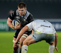 Ospreys' Olly Cracknell is tackled by Saracens' Jamie George<br /> <br /> Photographer Simon King/Replay Images<br /> <br /> European Rugby Champions Cup Round 5 - Ospreys v Saracens - Saturday 13th January 2018 - Liberty Stadium - Swansea<br /> <br /> World Copyright © Replay Images . All rights reserved. info@replayimages.co.uk - http://replayimages.co.uk