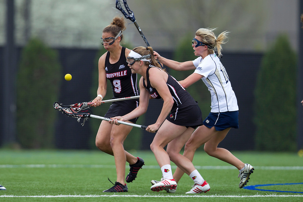 Louisville Cardinals defenseman CASEY PEPPERMAN (middle), Louisville Cardinals midfielder NIKKI BOLTJA (9), and Notre Dame Fighting Irish midfielder KATE NEWALL (16) battle for the loose ball in second half action at Arlotta Stadium.  Notre Dame defeated Louisville 13-11.