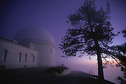 Lick Observatory. Telescope dome at sunset at the Lick Observatory on Mount Hamilton in California, USA. Completed in 1888 at an altitude of 1280 meters, the Lick Observatory was the world's first permanent mountaintop observatory. Its location provided excellent viewing conditions for years until light pollution from the nearby city of San Jose began to interfere with results. In 1997 the observatory is operated by California University. (1999)