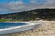 People walking dogs on white sand beach at Carmel Beach, Carmel, Monterey Peninsula, California