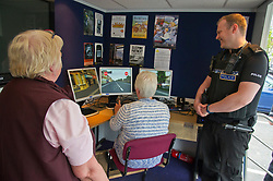 Pictured: Friends Marie Duffy (69) and Margaret Cannon (66) had a go on the simulator under the watchfull eye of PC Brain McGuff<br /> <br /> Destination Drive launch. The initiative aims to help older drivers stay safe on the road. Open invitation to first drop-in session where you can get a free assessment drive and try the current theory and hazard perception tests. <br /> <br /> Ger Harley | EEm 12 June 2018