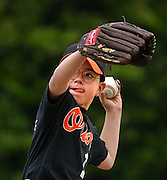 Conner DelBueno winds up a pitch for his Orioles eight-to-nine-year-old little league team in Rancho Cordova, California on May 8, 2003.