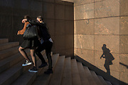 A couple climb the steps at 1, London Bridge in Southwark, on 10th October 2018, in London, England.