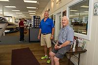 Bill and Jack Irwin in the showroom at Irwin Marine on Lake Winnipesaukee.  (Karen Bobotas for New England Boating Magazine)