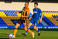 Hull City forward Josh Magennis (27) chased by AFC Wimbledon defender Will Nightingale (5) during the EFL Sky Bet League 1 match between AFC Wimbledon and Hull City at Plough Lane, London, United Kingdom on 27 February 2021.