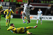 Swansea city's Wayne Routledge hurdles over Napoli's Blerim Dzemaili. UEFA Europa league match , Swansea city v Napoli at the Liberty Stadium in Swansea, South Wales on Thursday 20th Feb 2014. pic by Andrew Orchard, Andrew Orchard sports photography.