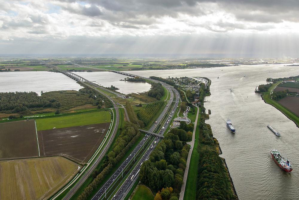 Nederland, Zuid-Holland, Dordrecht, 23-10-2013; Dordtsche Kil, schepen varen in de richting Hollandsch DIep , evenwijdig rijksweg A16 met brug voor autoverkeer en de brug van de HSL.<br /> River Dordtsche Kil, shipping towards Hollands Diep, HST bridge and motor traffic bridge.<br /> luchtfoto (toeslag op standaard tarieven);<br /> aerial photo (additional fee required);<br /> copyright foto/photo Siebe Swart.