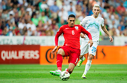 Chris Smalling of England vs Kevin Kampl of Slovenia during the EURO 2016 Qualifier Group E match between Slovenia and England at SRC Stozice on June 14, 2015 in Ljubljana, Slovenia. Photo by Vid Ponikvar / Sportida