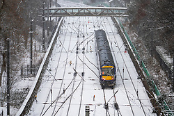 Edinburgh, Scotland, UK. 9 Feb 2021. Big freeze continues in the UK with Storm Darcy bringing several inches of snow to Edinburgh overnight. Pic; Train leaves Waverley Station. Iain Masterton/Alamy Live news