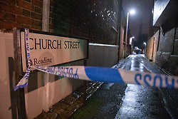 © Licensed to London News Pictures. 19/01/2021. Reading, UK. Police tape and a street sign on Church Street in Reading. At approximately 20:15GMT on Monday 18/01/2021 in Church Street, Reading, a man in his forties was assaulted by a group of unknown offenders with weapons who fled the scene after the assault. The victim was taken to hospital with injuries consistent with having been stabbed. Photo credit: Peter Manning/LNP