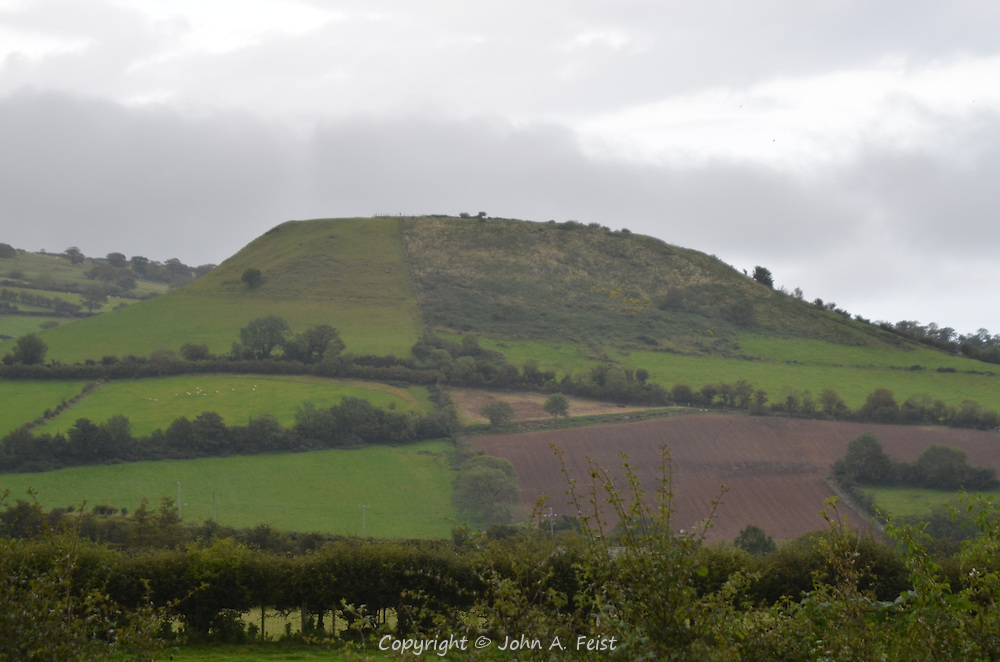 A mound in Cushendall, County Antrim, Northern Ireland.  We never found out the details, but neolithic burial mounds looking like this are all over the country.