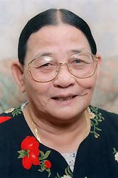 Portrait of elderly woman wearing