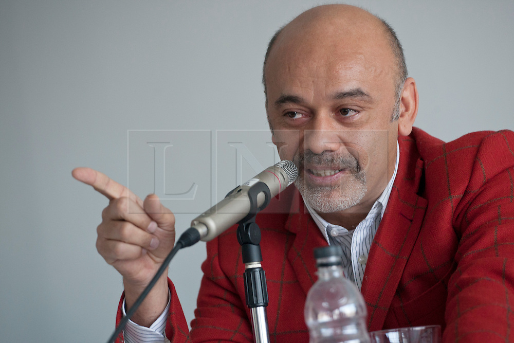 © licensed to London News Pictures. London, UK 30/04/2012. Christian Louboutin speaks at a press conference before opening his exhibition, which celebrating 20 years of the famous red soled footwear brand at Design Museum in London. Photo credit: Tolga Akmen/LNP