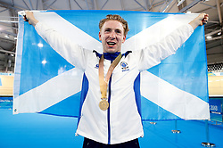 Scotland's Mark Stewart celebrates with the gold medal and flag after winning the Men's 40km Points Race Final at the Anna Meares Velodrome during day four of the 2018 Commonwealth Games in the Gold Coast, Australia.