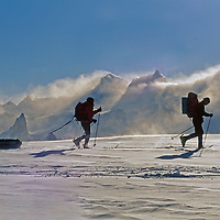 Expedition members ski near the wind-whipped Filchner Mountains in Queen Maud Land, Antarctica.