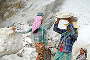 Women marble miners in Sagyin village on 19th May 2016 in Mandalay division, Myanmar. Sagyin, a village 21 miles north of Mandalay is known for its mountain range of seven hills containing marble stone. The marble blocks are carved into Buddha images of different styles and sent to Buddhist monasteries all around Myanmar. Nowadays more work is done by machines, but in the past everything was done by hand