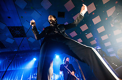 A wide angle shot from the photo pit of Nick Cave and the violinist-cum-flautist Warren Ellis, of Nick Cave and the Bad Seeds, on stage tonight at The Barrowlands, Glasgow, Scotland.<br /> ©Michael Schofield.