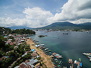 Aerial view of Papusungan village looking across the harbor to Bitung City, Sulawesi.
