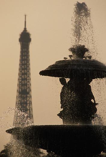Eiffel Tower and Place de la Concorde fountain Paris France