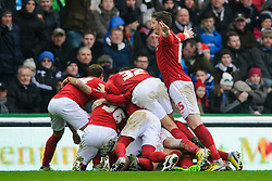 Nottingham Forest Defender Greg Halford (ENG) dives on top of a pile-on as his side celebrate after Midfielder Chris Cohen (ENG) scores a goal to give his side a 1-0 lead during the first half of the match - Photo mandatory by-line: Rogan Thomson/JMP - Tel: Mobile: 07966 386802 19/01/2013 - SPORT - FOOTBALL - Pride Park - Derby. Derby County v Nottingham Forest - npower Championship. The meeting of these two local sides is known as the East Midlands Derby with the winner claiming the Brian Clough Trophy.
