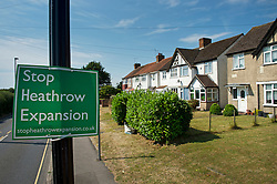 """© London News pictures...  01/07/2015. Harmondsworth, UK. A """"Stop Heathrow Expansion"""" signs in the village of Harmondsworth in West London. Harmondsworth is due to be demolished to make way for a third runway at Heathrow Airport if plans go ahead. The airports commission today (Weds) gave it's backing for the £18.6bn plan for a third runway at Heathrow. Photo credit: Ben Cawthra/LNP"""
