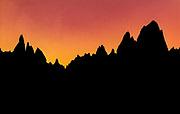 Winter sunset silhouette, Cerro Torre (left) & FitzRoy, Los Glaciares National Park, Patagonia, Argentina
