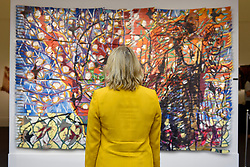 "© Licensed to London News Pictures. 12/05/2017. London, UK.   A staff member views ""Icarus Chocolate"", 2013, by Francisco Vidal (Est. GBP 15-20k) at the preview for the first sale dedicated to Modern and Contemporary African Art at Sotheby's New Bond Street.  The sale features over 115 artworks by over 60 different artists from 14 countries across the continent. Photo credit : Stephen Chung/LNP"