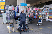On the day that Elephant & Castle Shopping Centre closes before its demolition and redevelopment, market stallholders like Nassim clear away their pitches before gates are locked for the final time after 55 years, on 24th September 2020, in south London, England. The much-criticised architecture of the Elephant & Castle Shopping Centre was opened in 1965, built on the bomb damaged site of the former Elephant & Castle Estate, originally constructed in 1898. The centre was home to restaurants, clothing retailers, fast food businesses and clubs where south Londoners socialised and met lifelong partners.