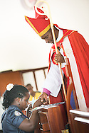 Led by Bishop Emmanuel Makala, a new deaconess is commissioned during a service with more than 1,000 worshippers on Sunday, March 15, 2015, at the Evangelical Lutheran Church in Tanzania – South-East of Lake Victoria Diocese's (ELCT-SELVD) Ebenezer Cathedral in Shinyanga, Tanzania. LCMS Communications/Erik M. Lunsford