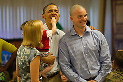 Eight month old Cooper Wall Wagner as Cooper sticks his fingers in US President Barack Obama's mouth as the President poses for a picture with Cooper's parents Greg and Meredith Wagner in Kaneohe, Hawaii, USA on Sunday, December 25, 2011.   The President and Mrs. Obama make their annual trip to greet current and retired members of the US military and their families as they eat a Christmas Day meal Anderson Hall mess hall at Marine Corps Base Hawaii. Photo by Kent Nishimura/ABACAPRESS.COM    302579_007 Kaneohe Etats-Unis United States