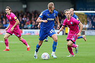 AFC Wimbledon attacker Marcus Forss (15) dribbling during the EFL Sky Bet League 1 match between AFC Wimbledon and Rochdale at the Cherry Red Records Stadium, Kingston, England on 5 October 2019.
