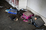 School bags and a burned trumpet are left at the entrance of the school in Ishinomaki city.