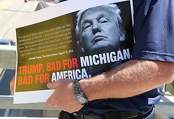 As Republican presidential candidate Donald Trump speaks inside to a business crowd at the Detroit Economic Club at Cobo Center, a protestor holds a sign showing his perspective Monday, August 8, 2016 in downtown Detroit, MI, USA. Photo by Regina H. Boone/Detroit Free Press/TNS/ABACAPRESS.COM