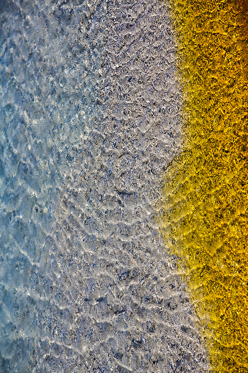 beautiful yellow, blue, and clear water of a hot spring