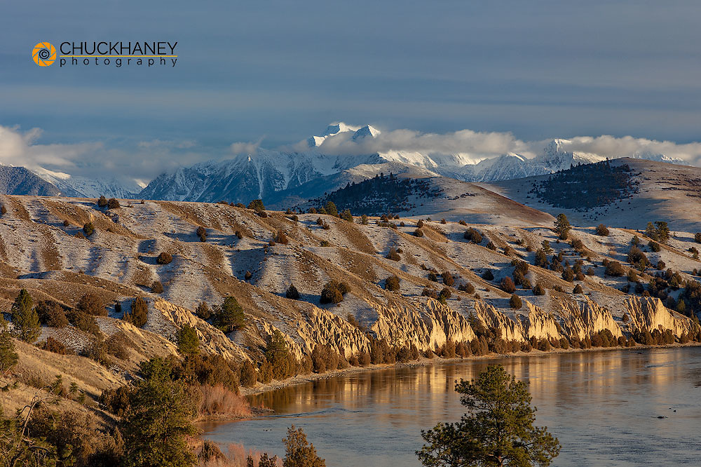 McDonald Peak and the Mission Mountains loom over the Flathead River in early winter in the Mission Valley, Montana, USA
