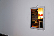 small old style mirror on a big white wall