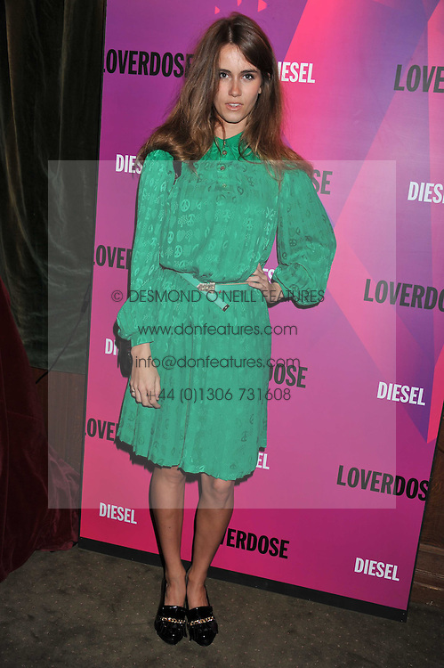 JADE WILLIAMS - Sunday Girl at a party tocelebrate the launch of Diesel's new female fragrance 'Loverdose' held at The Box, 11-12 Walkers Court, Brewer Street, London on 7th September 2011.