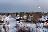 A waxing gibbous moon rises over Nenana, December 5, 2019