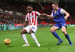 Stoke City's Saido Berahino (left) and Ipswich Town's Mathew Pennington battle for the ball