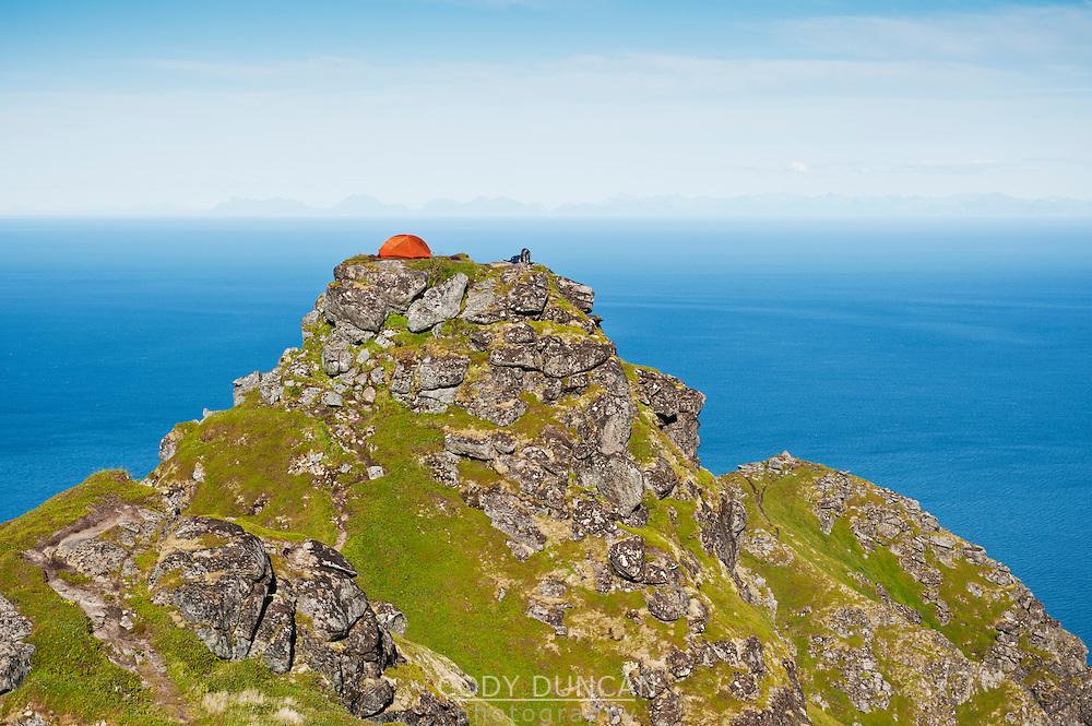 Tent camping on Reinebringen mountain peak, Reine, Lofoten islands, Norway