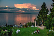 Sunset illuminates thunderheads over Nahuel Huapi Lake, seen from San Carlos de Bariloche (Bariloche for short), a resort town in Nahuel Huapi National Park, Río Negro Province, Argentina, Andes foothills, South America.